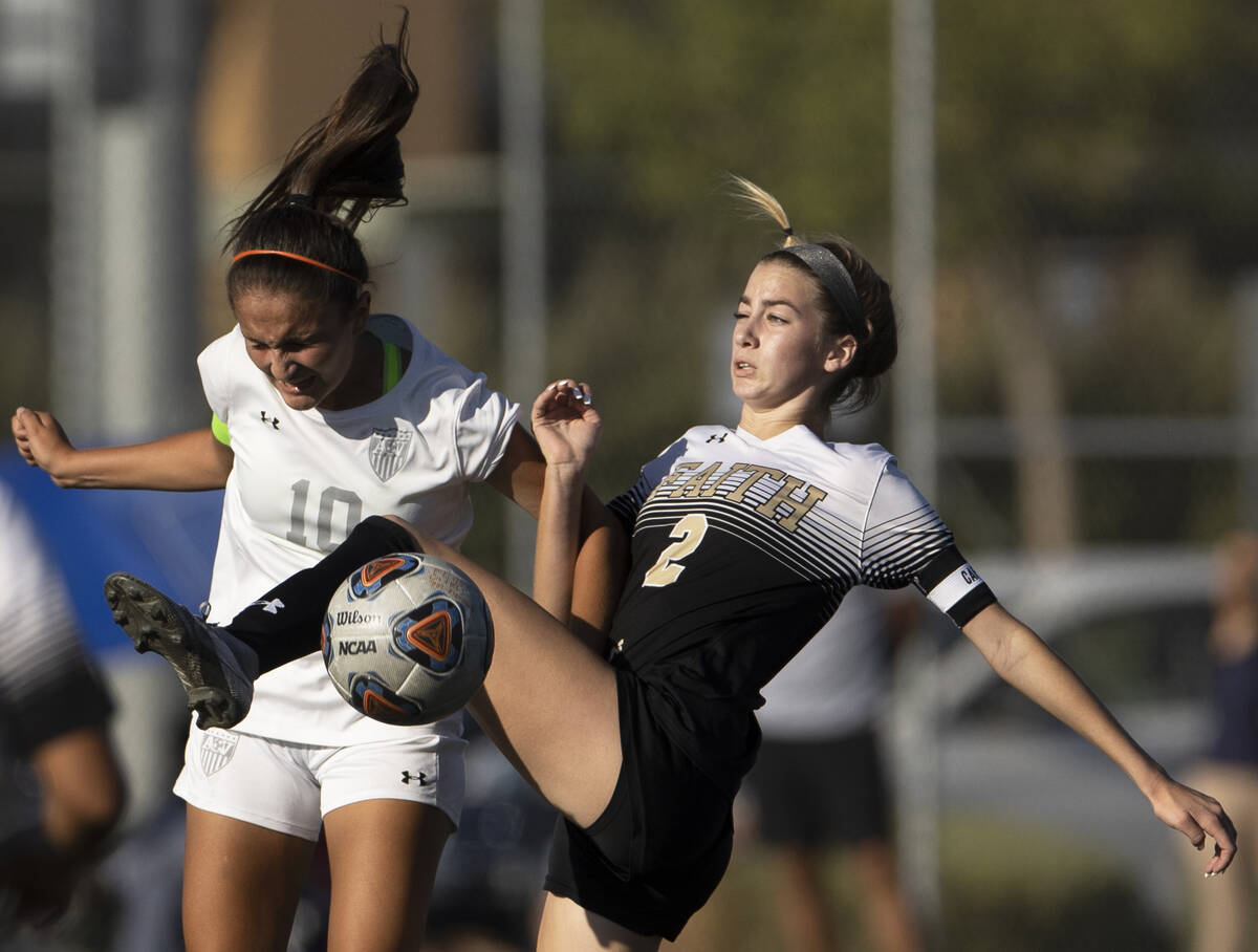 Arbor View's Elisa Corvalan (10) and Faith Lutheran's Taylor Day (2) fight for po ...