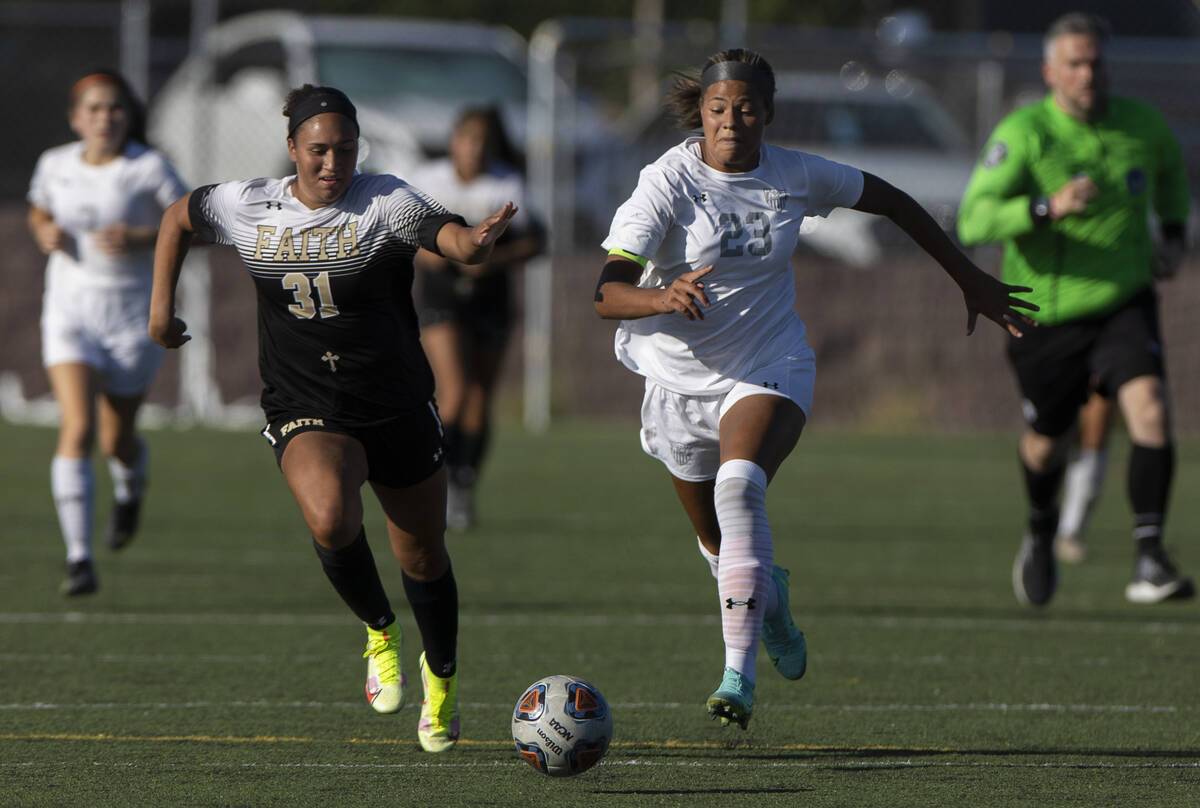 Arbor View's Tiana Beavers (23) pushes the ball up field past Faith Lutheran's Br ...