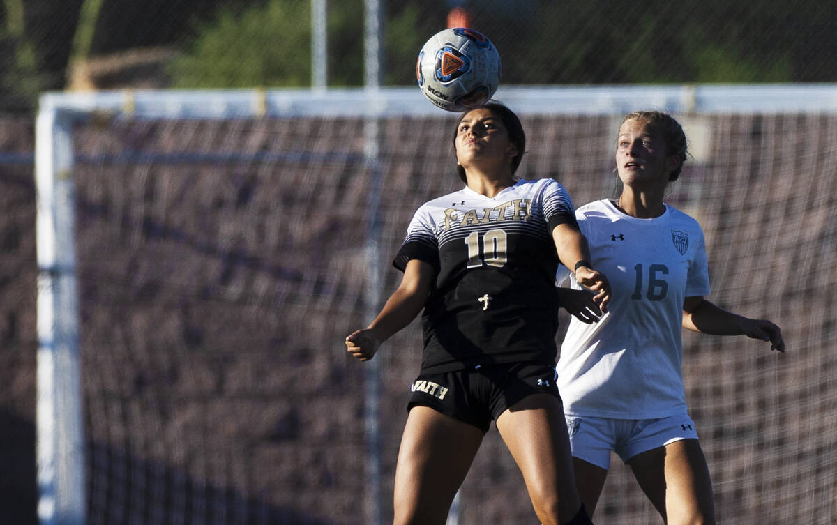 Faith Lutheran's Andrea Leyva (10) and Arbor View's Isabella Srodes (16) fight fo ...