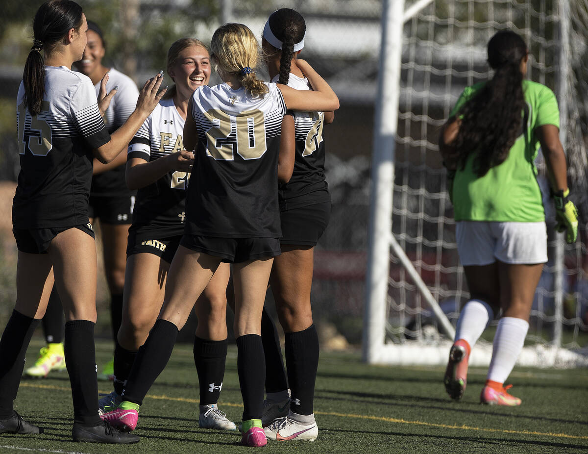 Faith Lutheran players celebrate a goal during a girls high school soccer game against Arbor Vi ...