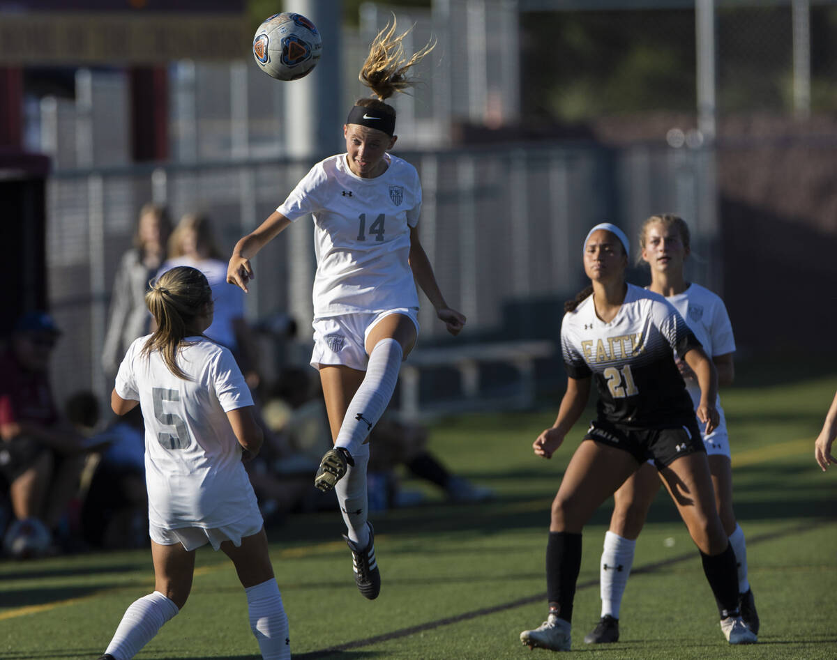 Arbor View's Madison Little (14) heads the ball to teammate Taya Bohenko (5) with Faith ...