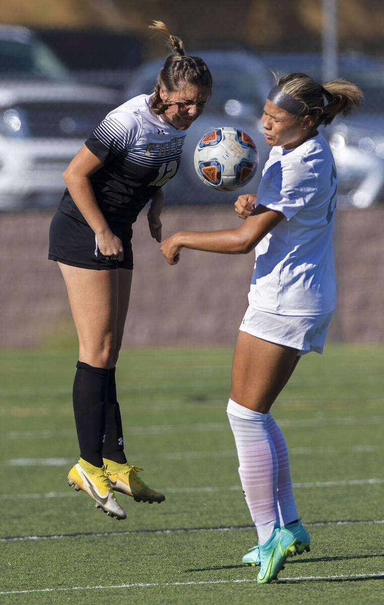 Arbor View's Tiana Beavers (23) and Faith Lutheran's Lindley Amick (12) fight for ...