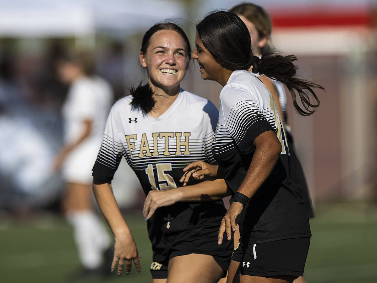 Faith Lutheran's Serene Gronauer (15) and Andrea Leyva (10) celebrate a goal during a gi ...