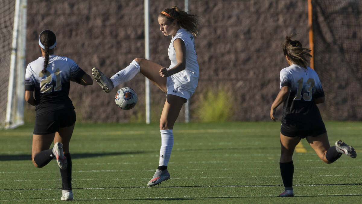 Arbor View's Brynn Covington (20) fights for possession with Faith Lutheran's Mia ...