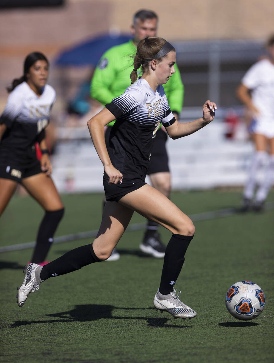 Faith Lutheran's Taylor Day (2) moves the ball up field during a girls high school socce ...