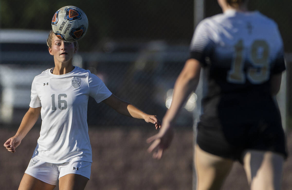 Arbor View's Isabella Srodes (16) heads a ball with Faith Lutheran's Charlotte Mc ...
