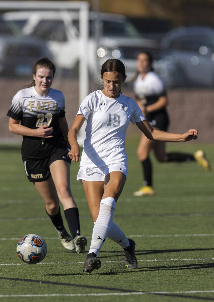 Arbor View's Bridget Guevara (19) passes the ball past Faith Lutheran's Christina ...