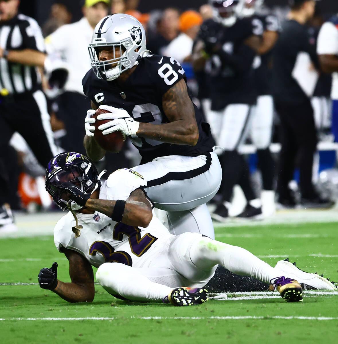 Raiders tight end Darren Waller (83) carries a ball as Baltimore Ravens defensive back DeShon E ...