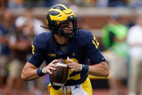 Michigan quarterback Cade McNamara plays against Western Michigan during an NCAA football game ...
