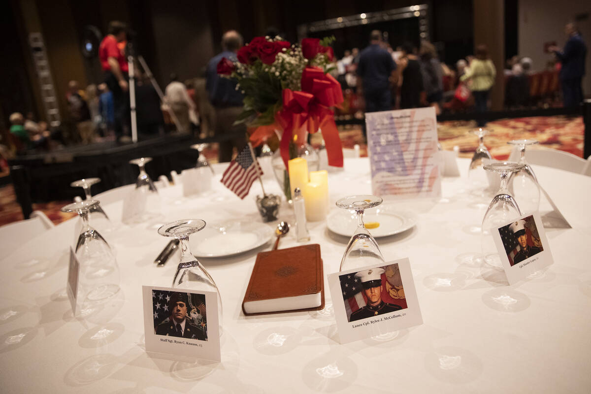 A table is set with photos of the thirteen United States service members killed during the Kabu ...