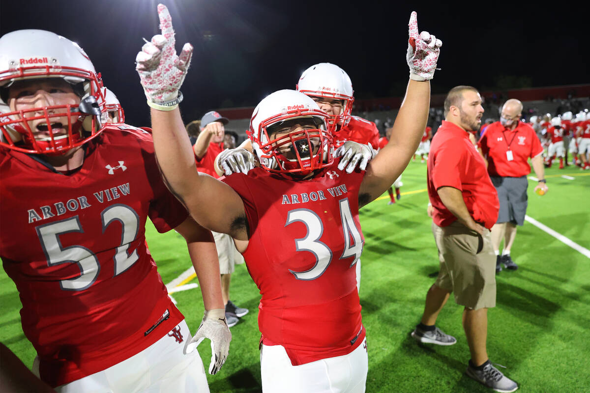 Arbor View's Gage Williams (52) and Jaden Jackson (34) celebrate their win against Desert Pines ...