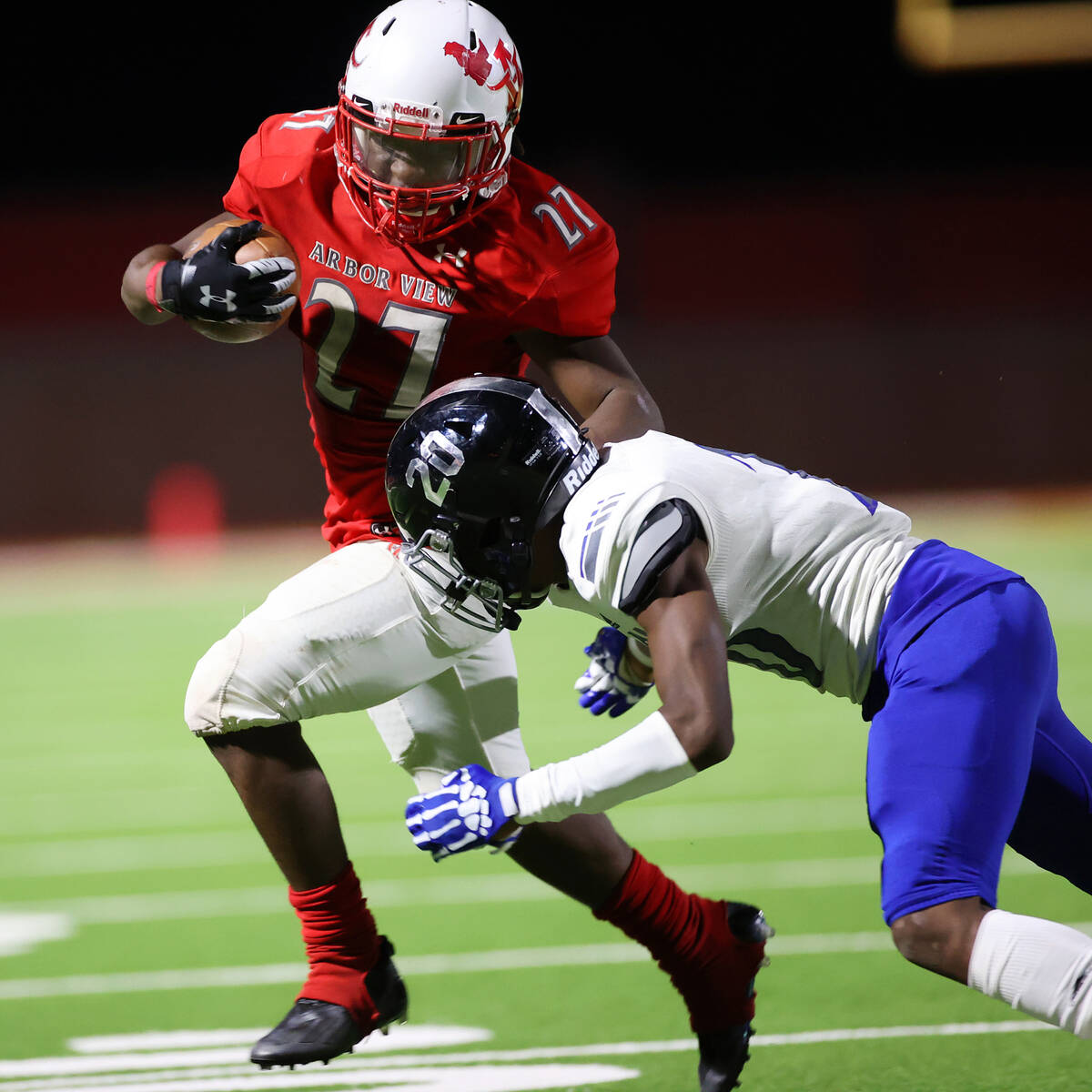 Arbor View's Makhai Donaldson (27) runs the ball before getting tackled by Desert Pines Isaiah ...