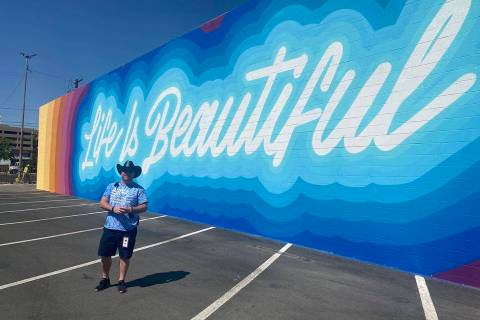 Craig Nyman poses in front of the just-finished Life Is Beautiful mural in downtown Las Vegas o ...