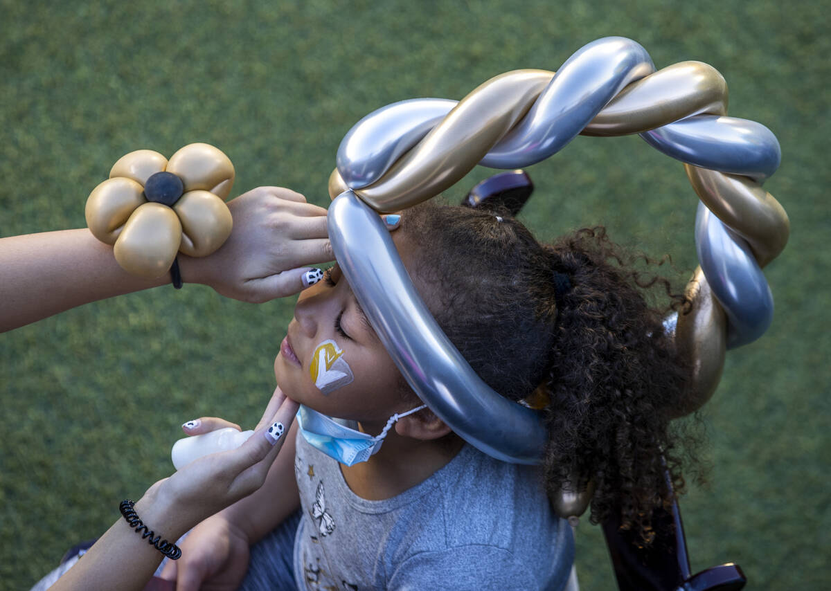 Kendall Quezada, 7, has her face painted during the Golden Knights annual Fan Fest at the Downt ...