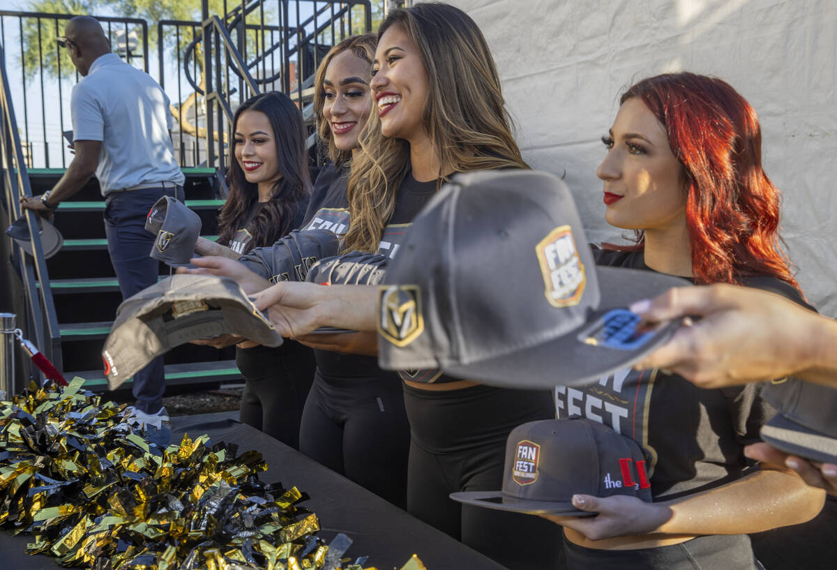 Commemorative hats are given out at the entrance during the Golden Knights annual Fan Fest at t ...