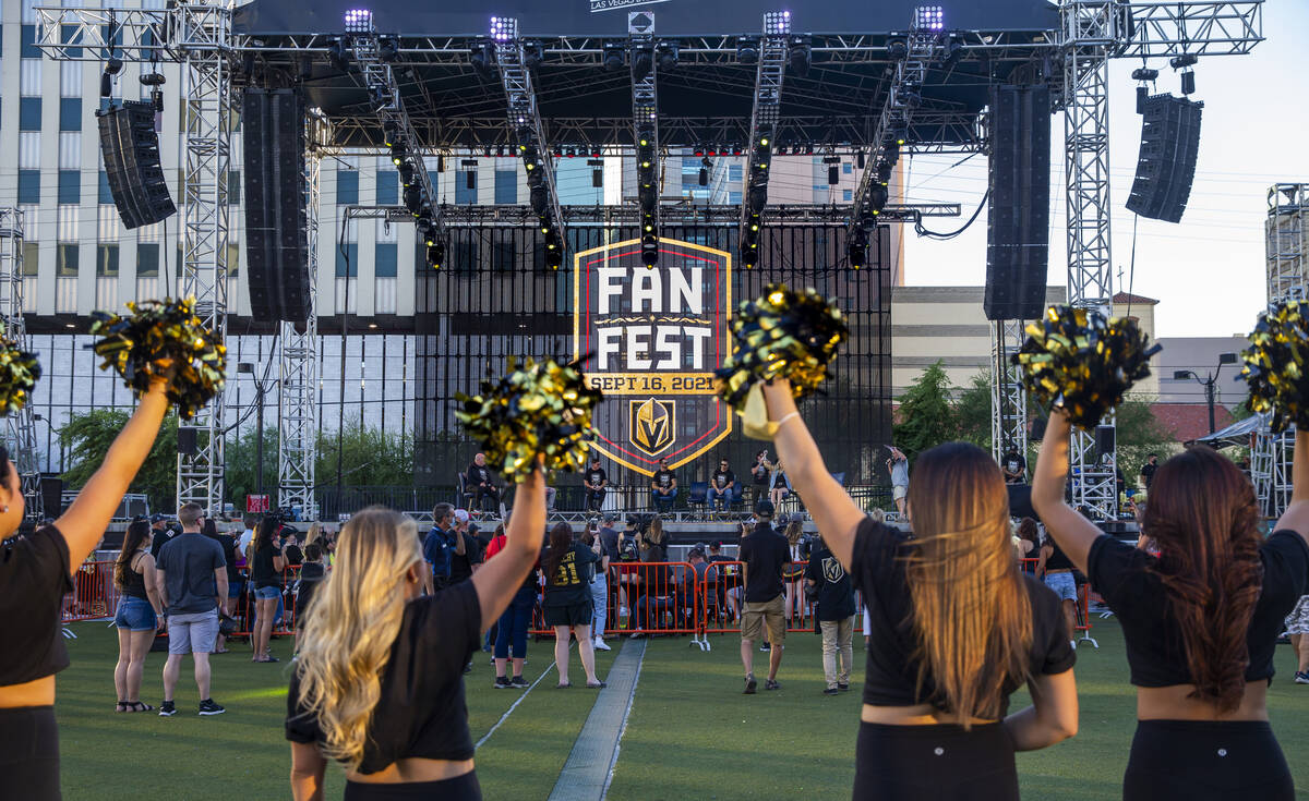 Las Vegas Vivas cheer for players on the stage during the Golden Knights annual Fan Fest at the ...