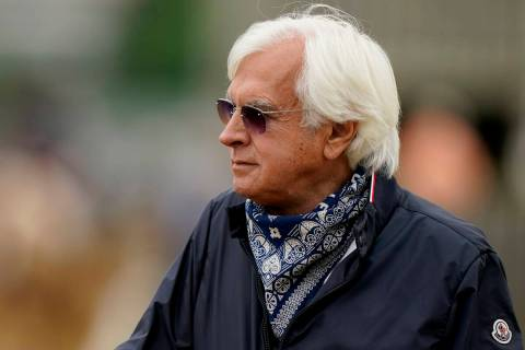 FILE - In this April 28, 2021, file photo, horse trainer Bob Baffert watches workouts at Church ...
