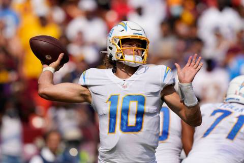 Los Angeles Chargers quarterback Justin Herbert (10) throws the ball during the second half of ...