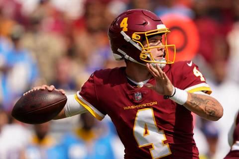 Washington Football Team quarterback Taylor Heinicke (4) throws the ball during the first half ...