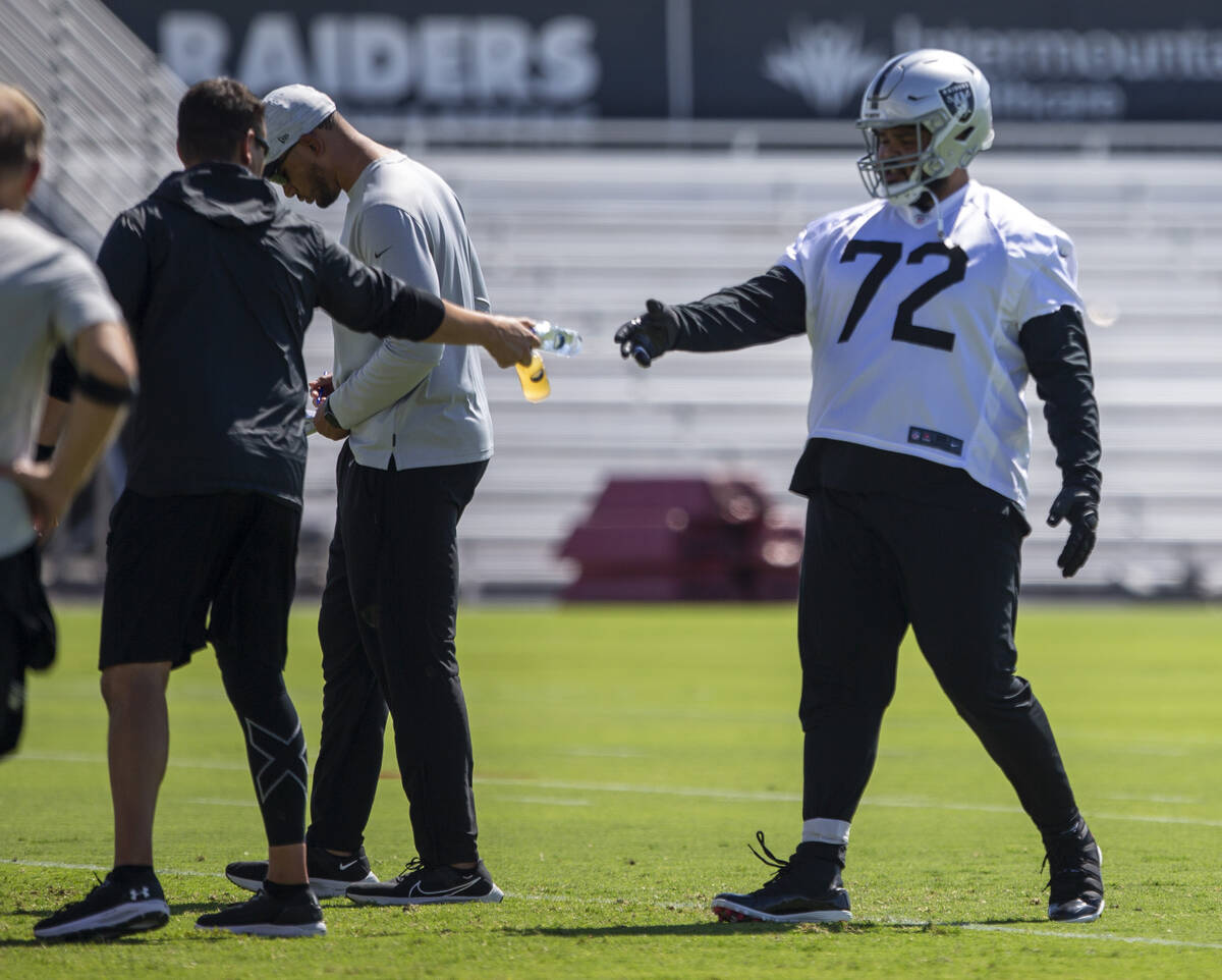 Raiders offensive tackle Jermaine Eluemunor (72) grabs a water during team practice at the Raid ...