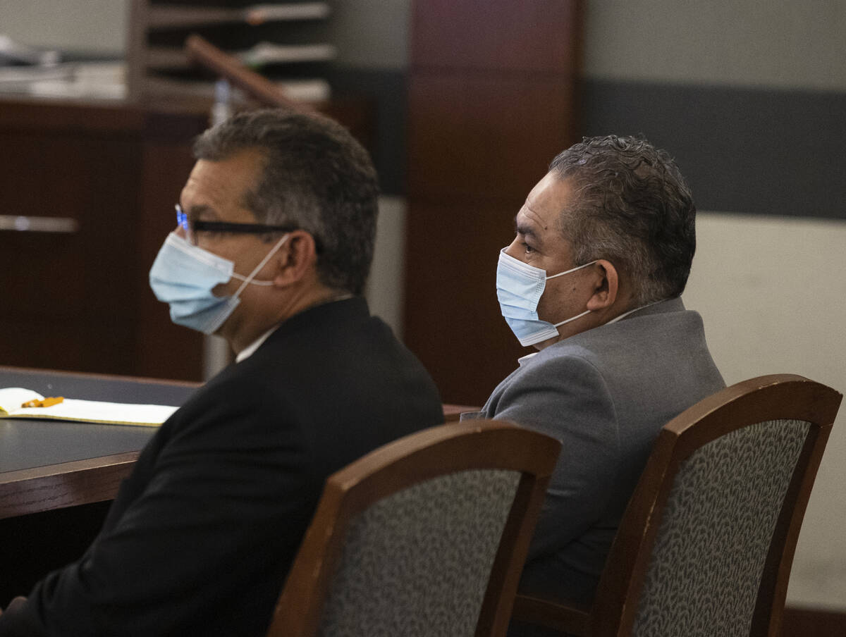 Omar Rueda-Denvers, right, and his attorney Christopher Oram listen as Eckley Keach, a prosecut ...