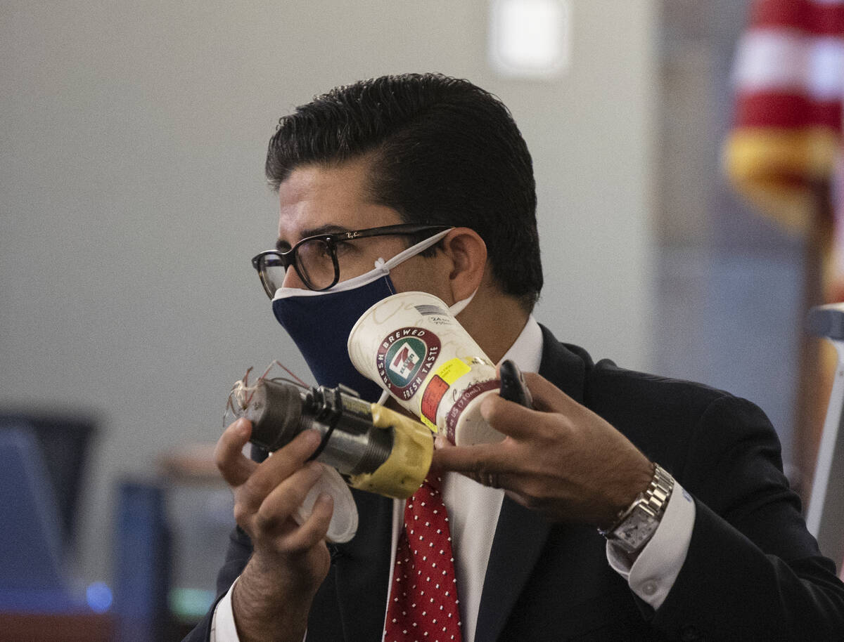 Eckley Keach, a prosecutor, holds a type of pipe bomb as he delivers a closing arguments during ...