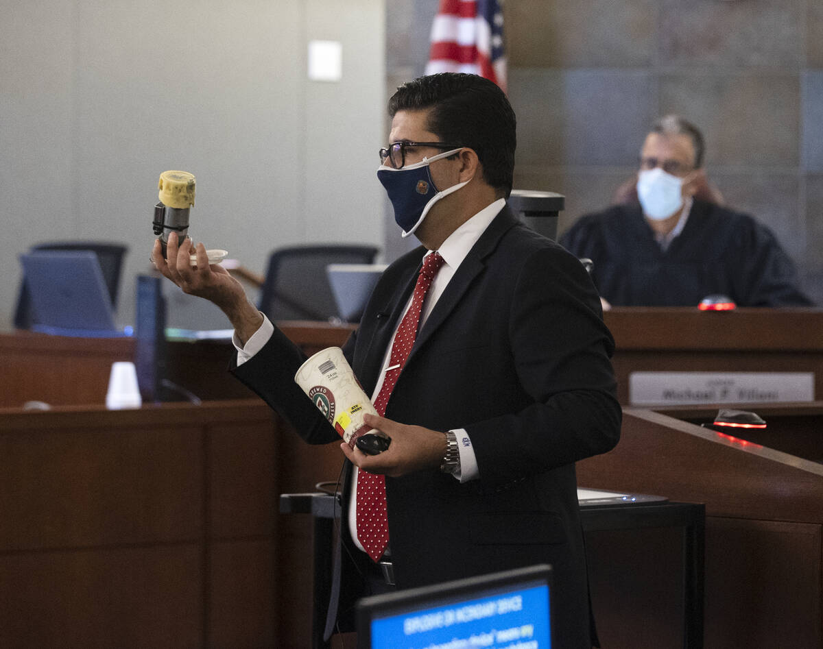 Eckley Keach, a prosecutor, holds a type of pipe bomb as he delivers a closing arguments as Jud ...