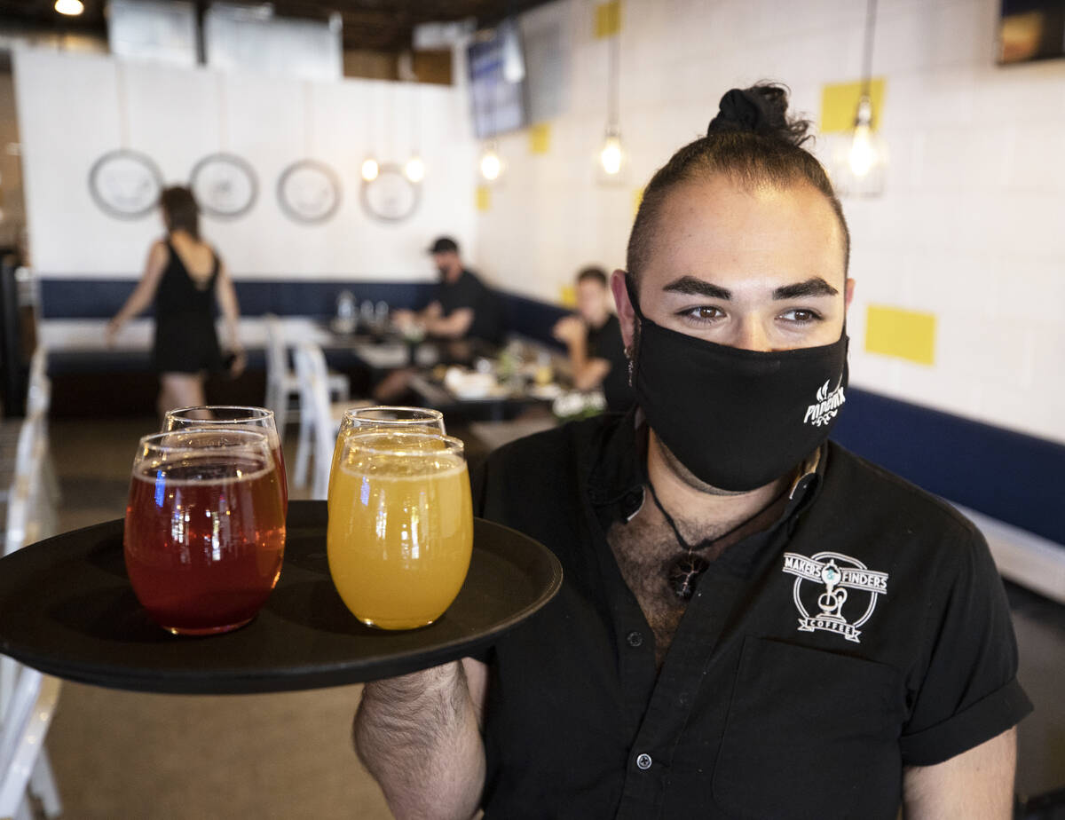 Server Julian Galvan brings drinks to a table at Makers & Finders on Wednesday, Sept. 15, 2 ...