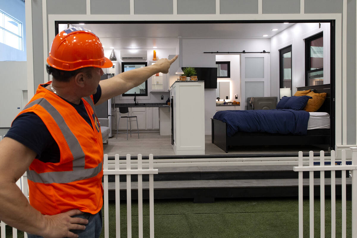 Boxabl CEO Paolo Tiramani shows a fully assembled casita unit at the company's factory space o ...