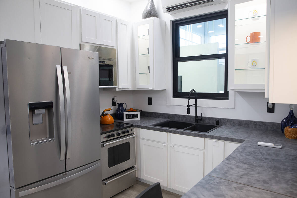 The kitchen in a 375-square-foot Boxabl Casita includes a full-sized refrigerator as well as an ...