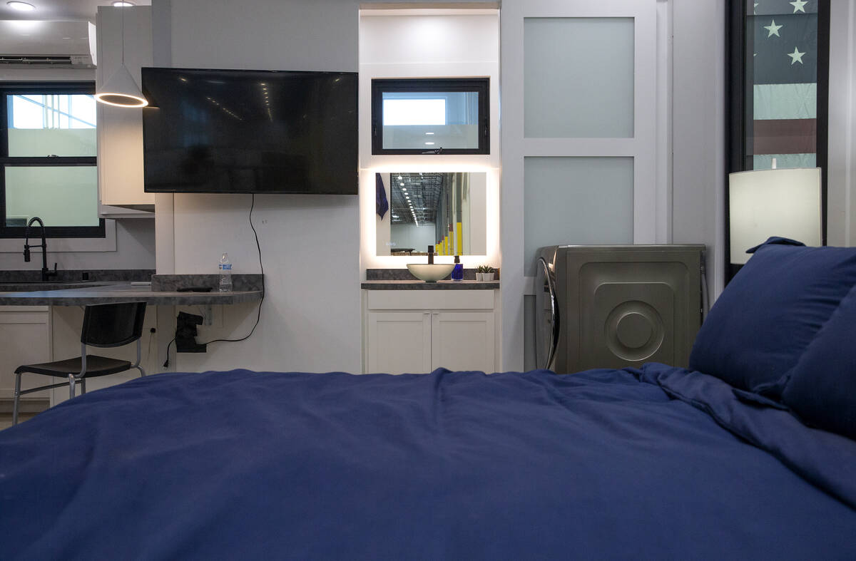 The kitchen, bathroom and washing machine can be seen from the bedroom of the 375-square-foot B ...