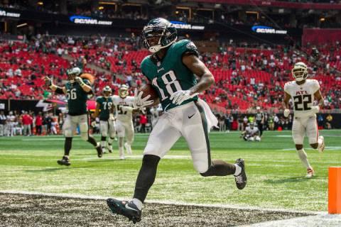 Philadelphia Eagles wide receiver Jalen Reagor (18) scores a touchdown during the second half o ...