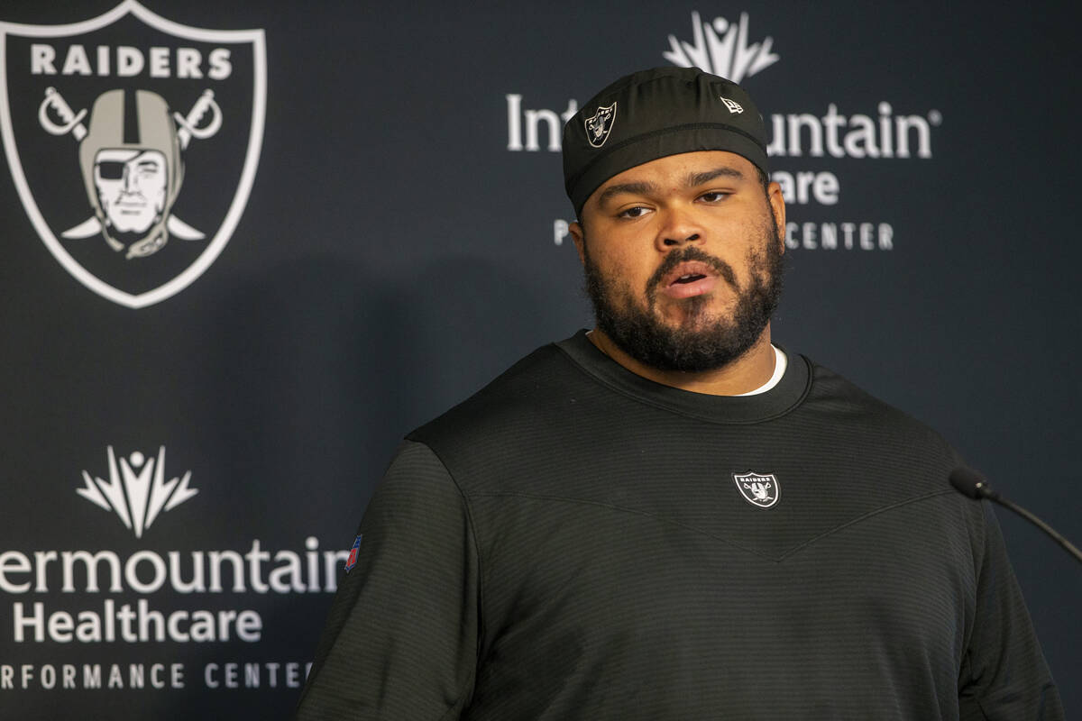 Raiders offensive tackle Jermaine Eluemunor takes questions from the media during a news confer ...