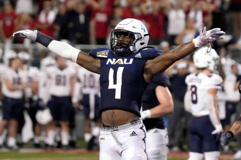 Northern Arizona defensive back Brenndan Johnson (4) reacts after stopping Arizona on a two poi ...