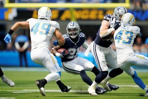 Dallas Cowboys running back Ezekiel Elliott (21) runs against the Los Angeles Chargers during t ...