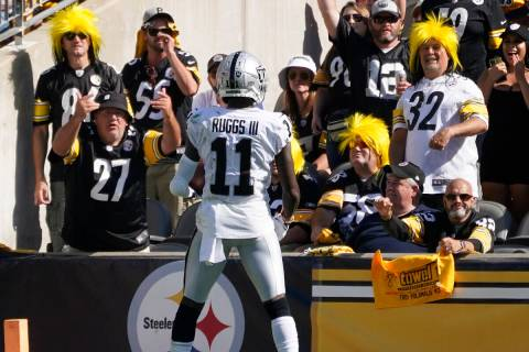 Las Vegas Raiders wide receiver Henry Ruggs III (11) celebrates his touchdown in the end zone d ...