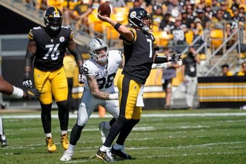Pittsburgh Steelers quarterback Ben Roethlisberger (7) throws a pass under pressure by Las Vega ...