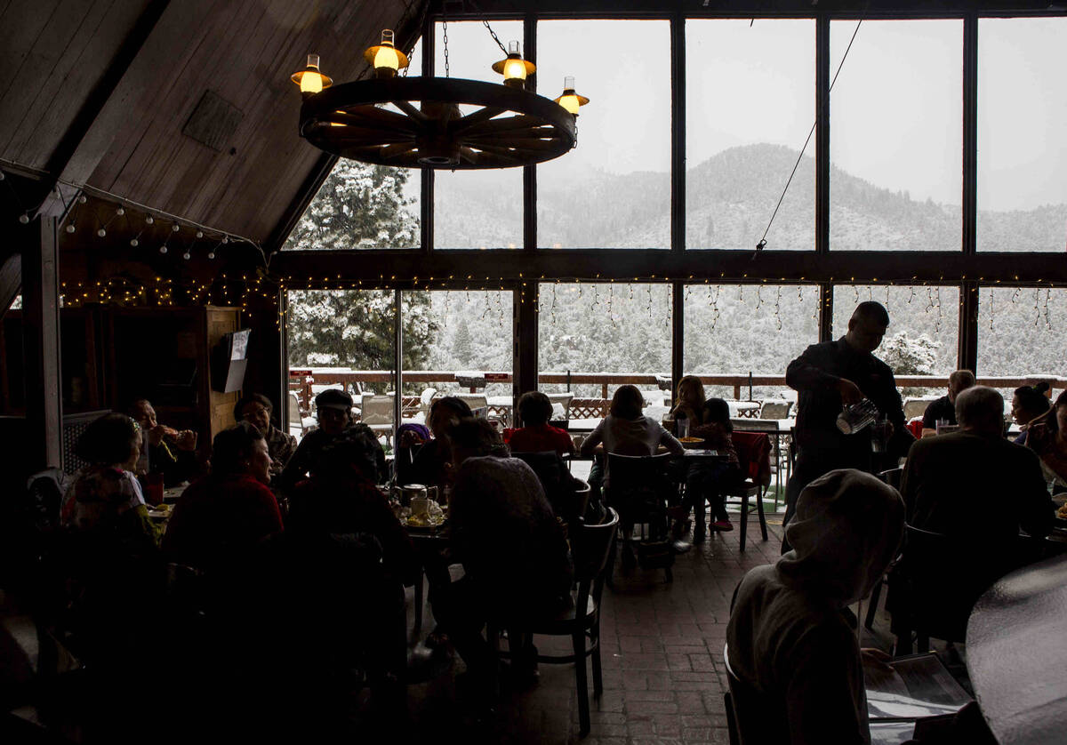 Customers eat and check out the views at Mount Charleston Lodge on Tuesday, May 1, 2018. (Revie ...