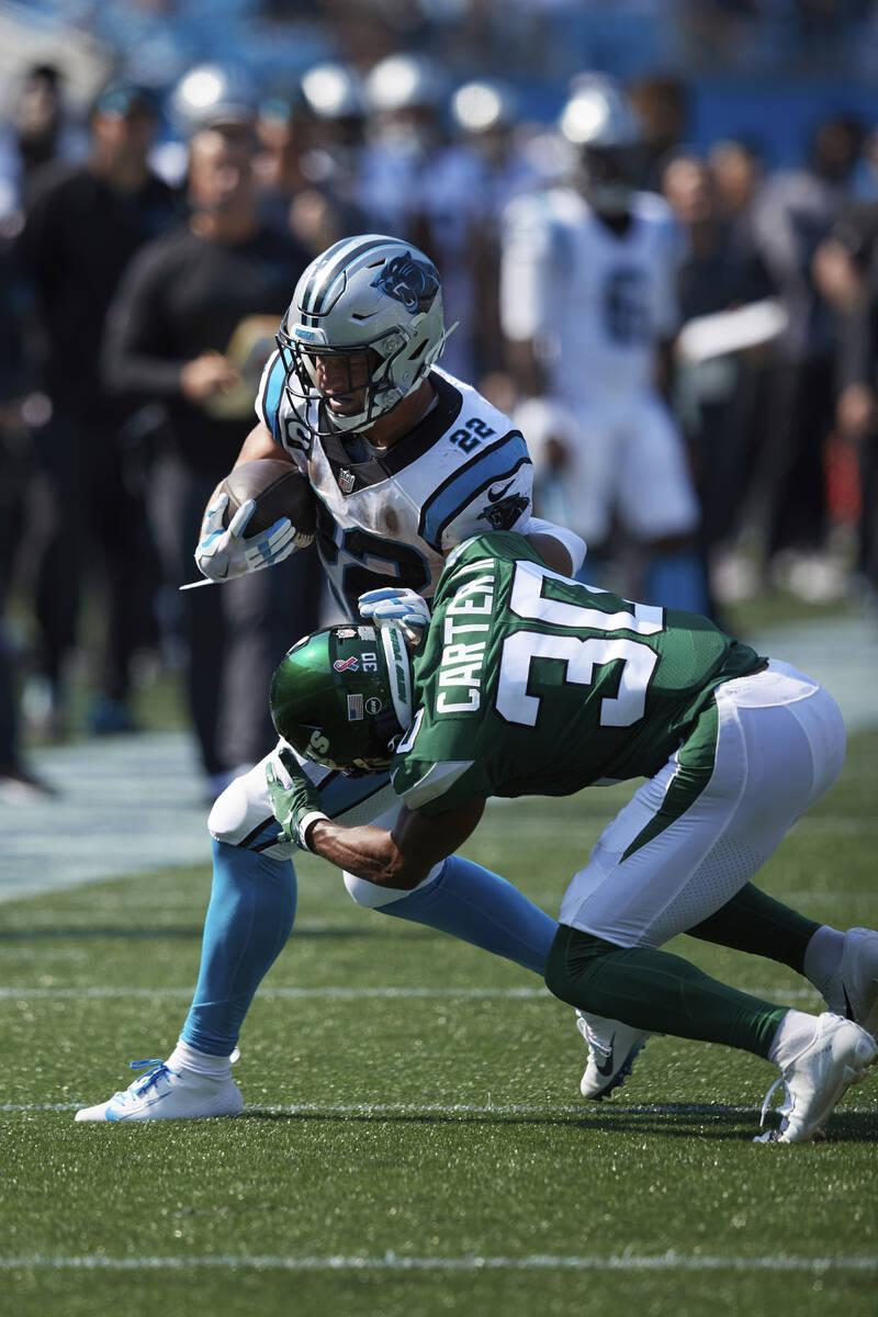 Carolina Panthers running back Christian McCaffrey (22) is hit by New York Jets cornerback Mich ...