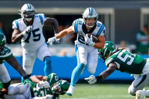Carolina Panthers running back Christian McCaffrey (22) runs the football against the New York ...