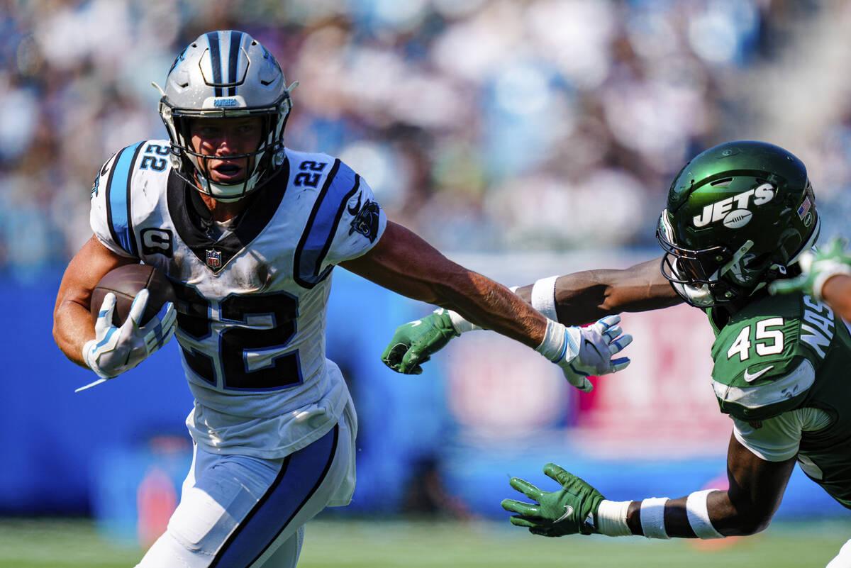 Carolina Panthers running back Christian McCaffrey pushes away New York Jets linebacker Hamsah ...