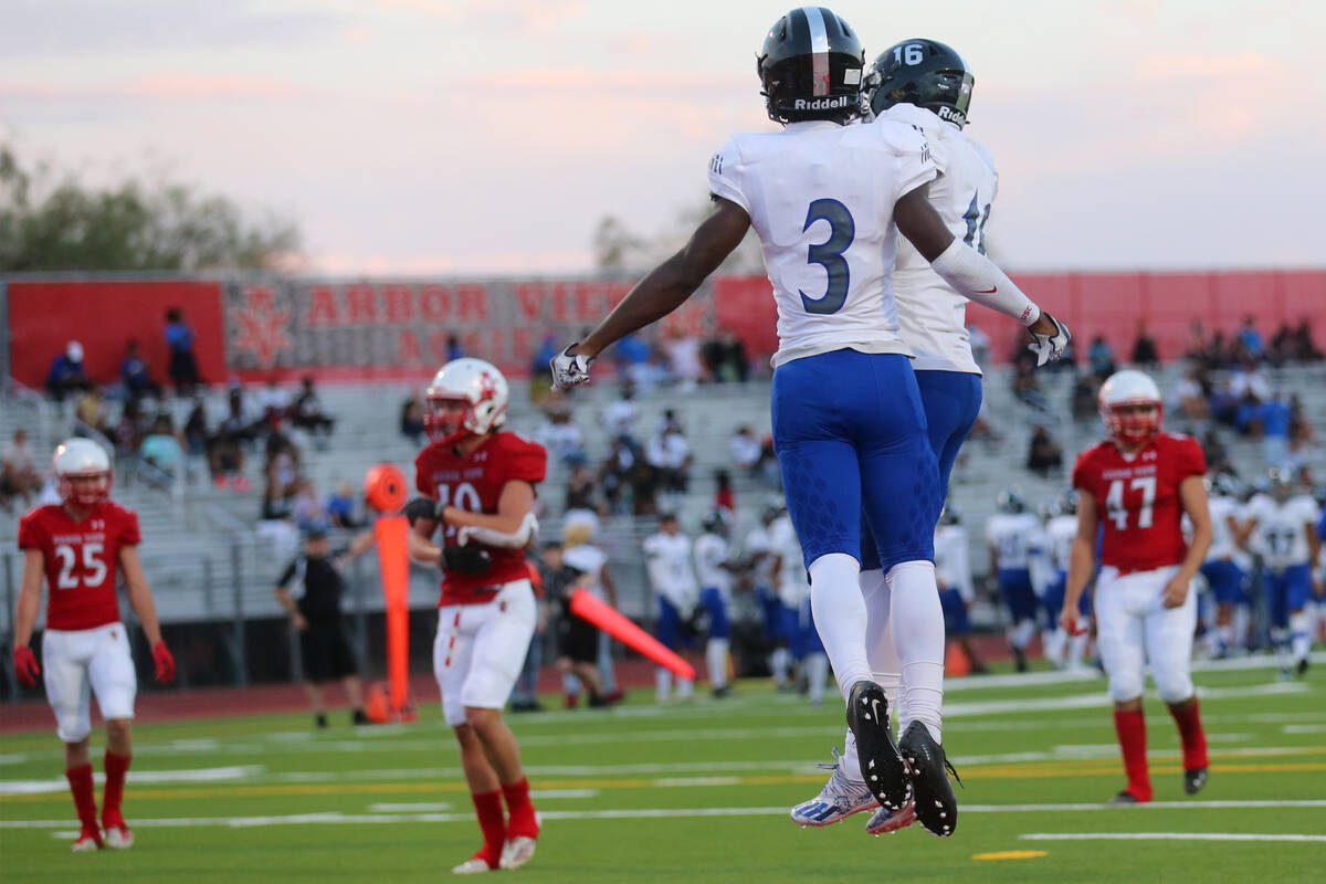 Desert Pines Lavon Brown (3) celebrates a touchdown with Alex Swift (16) in the first half of a ...