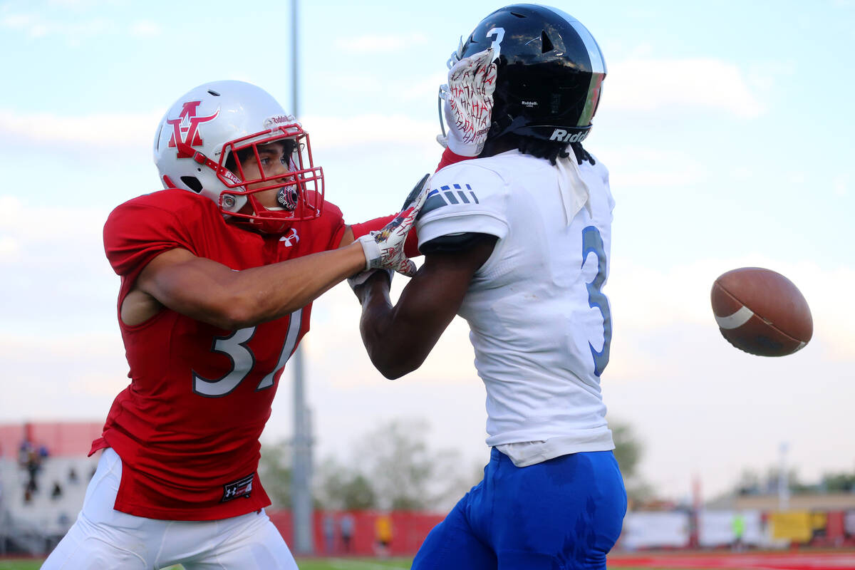 Arbor View's Jason Sermons (37) breaks up a pass intended for Desert Pines Lavon Brown (3) in t ...