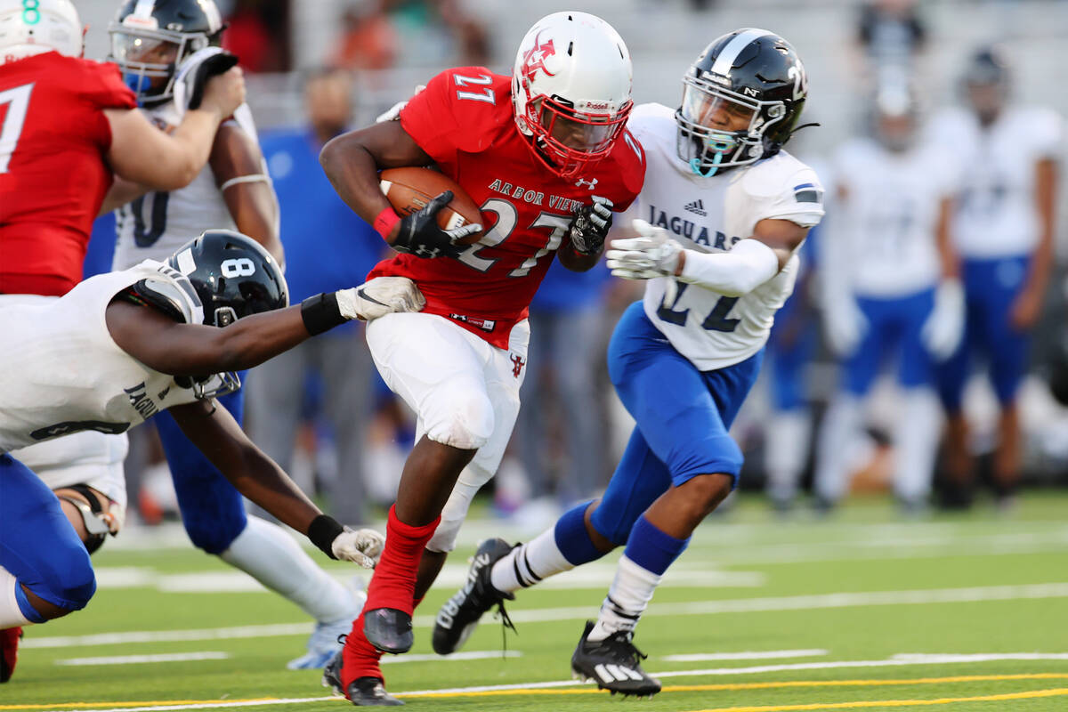 Arbor View's Makhai Donaldson (27) runs the ball before getting tackled by Desert Oasis Labarri ...