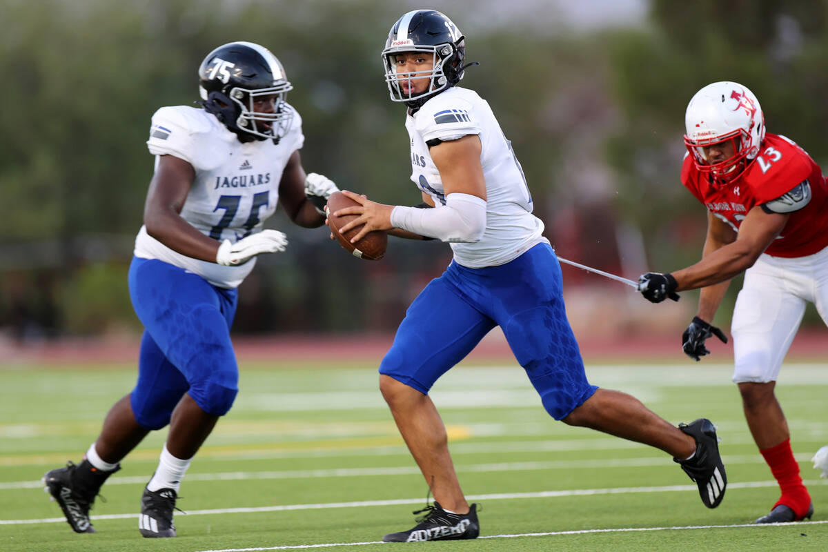 Arbor View's Toa Howard (23) misses a tackle of Desert Pines quarterback Rjay Tagataese (12) in ...