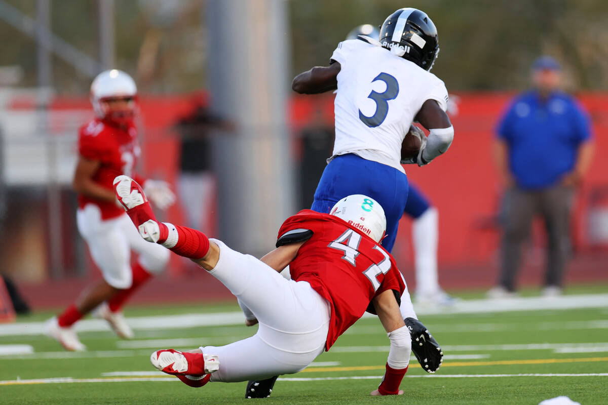 Desert Pines Lavon Brown (3) dodges a tackle against Arbor View's Christian Thatcher (42) befo ...