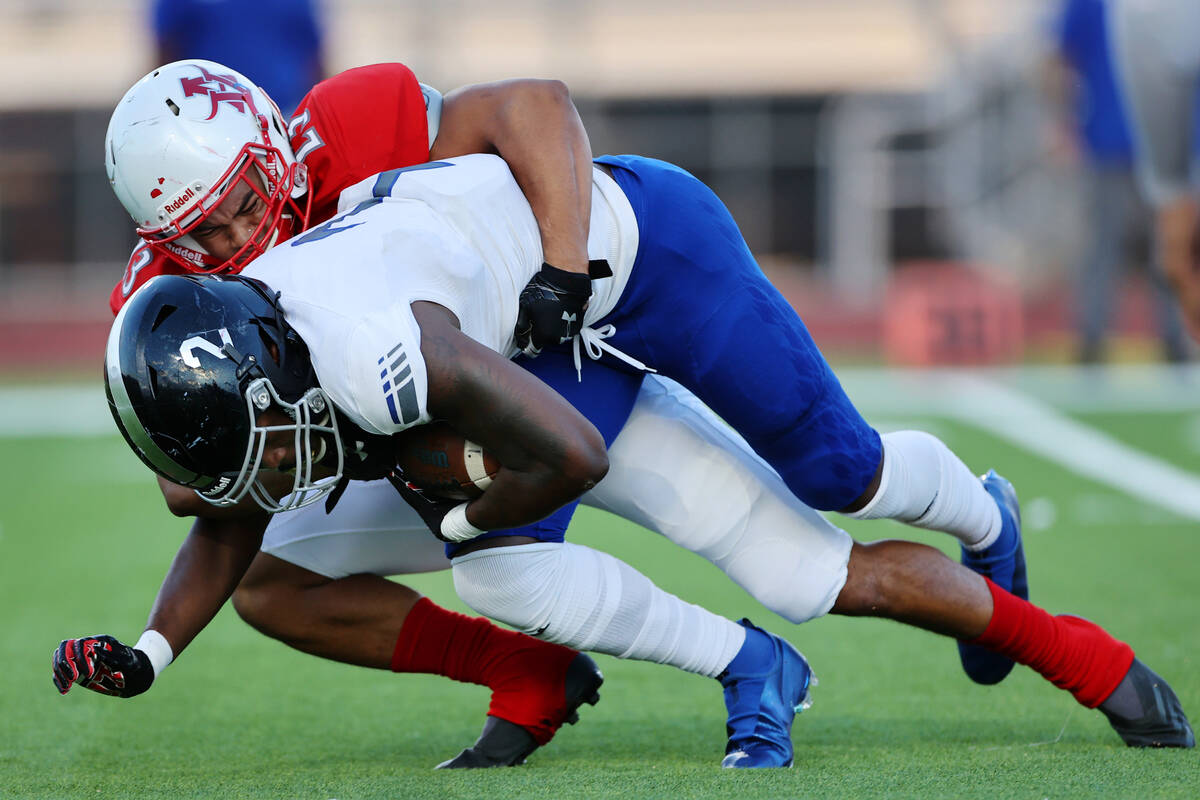 Arbor View's Toa Howard (23) tackles Desert Pines Javontae Barnes (2) in the first half of a fo ...