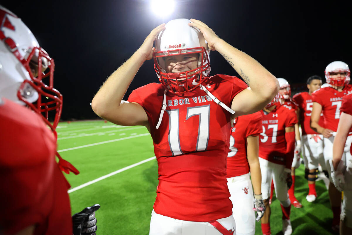 Arbor View's quarterback Kyle Holmes (17) celebrates after defeating Desert Pines 22-21 in a fo ...