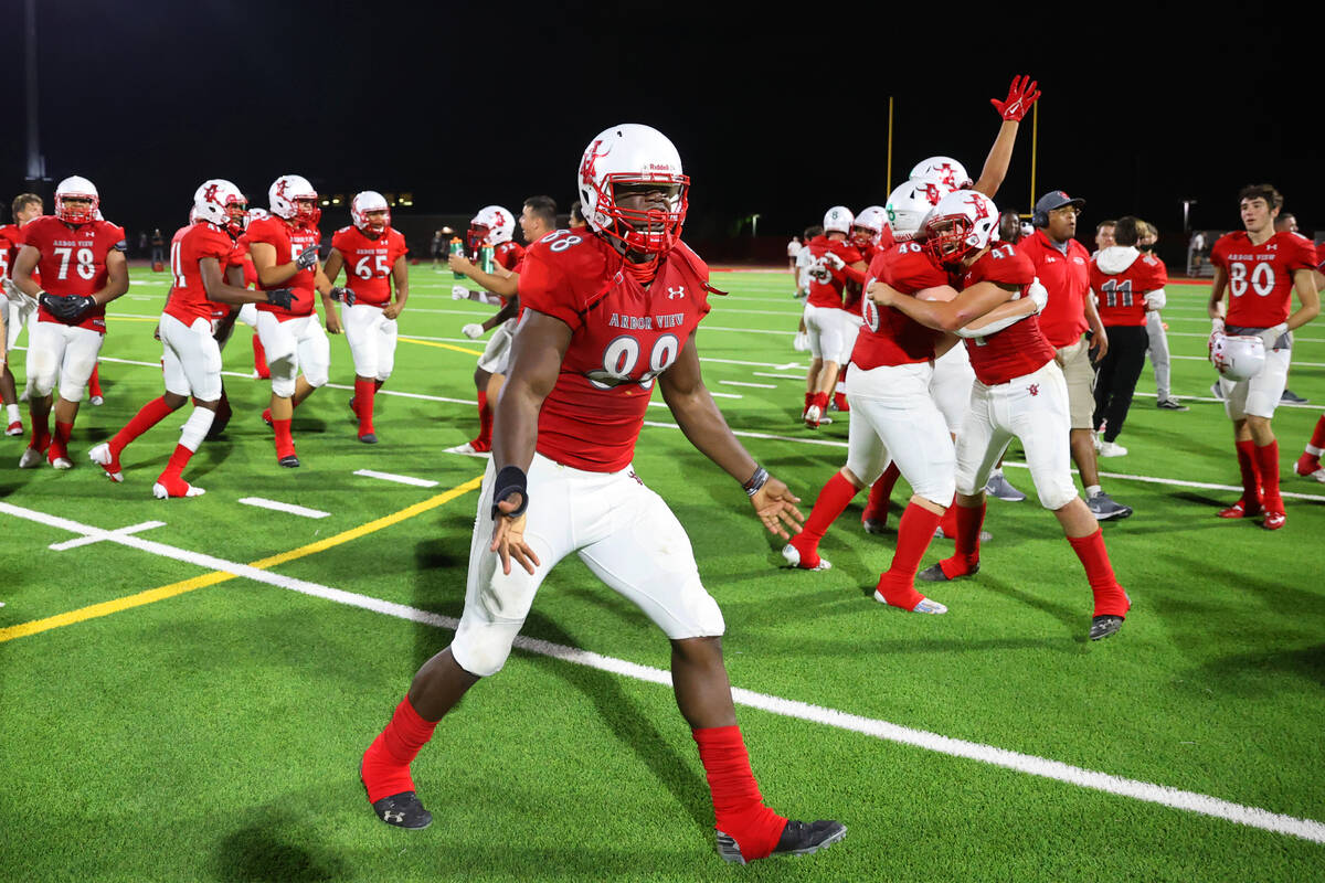 Arbor View's Zurich Ashford (88) celebrates his team's win over Desert Pines 22-21 in a footbal ...