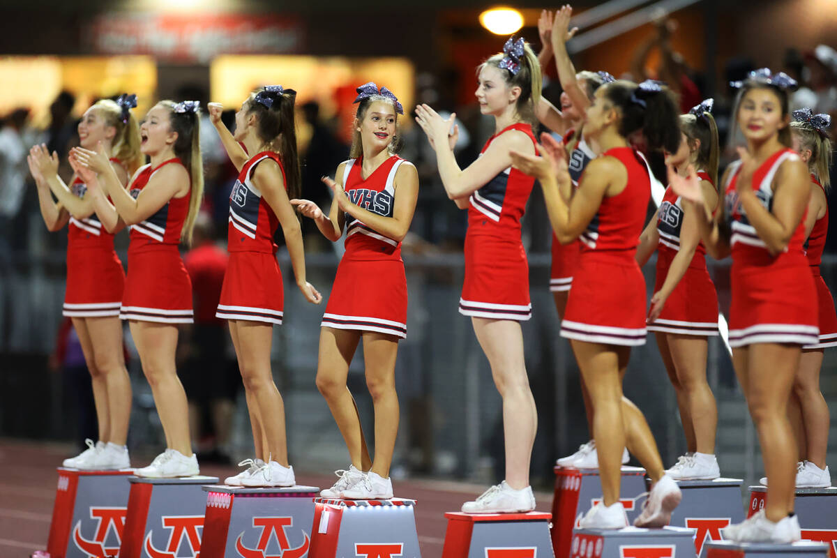 Cheerleaders watch from the sideline during the second half of a football game between Arbor Vi ...